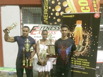 The top lifters of yesterday, Roger Callendar, Andrea Smith and Kevin Briglall posing with their spoils.