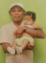 Joao De Souza with his child in happier times