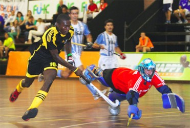 Guyana's Jamarj Assanah in the process of scoring his goal during the Guyana's opening matchup with Argentina