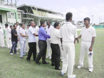 East Coast captain introducing the sponsors and DCB Executives to the players. From right: Rabindra Budhai (DFGI Accountant), Rabindranauth Basil (DFGI Assistant Manager), Anand Sanasie (DCB Vice-President) and Nazimul Drepaul (DCB Chairman of Junior Selector)
