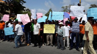 Sugar workers in an animated protest outside Parliament Buildings yesterday before the Committee of Supply began consideration of estimated spending for the year.