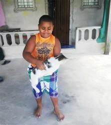 Nicholas Tappin and his camera shy cat Moses