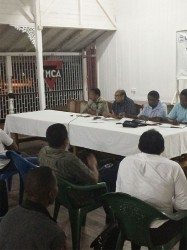 "The top brass of the GOA interacting with members of the public and association heads on Friday at the YMCA during the  Public Consultation on ""the Way Forward for Sport in Guyana."