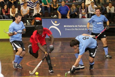 Guyana's Jamarj Assanah being challenged by Uruguay's German Asperger during the team's group matchup on Wednesday.