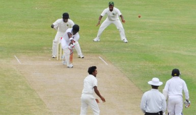 Leg spinner Davendra Bishoo claims the prized wicket of West Indies left-hander Darren Bravo who was plumb lbw. (Clifton Ross photo)