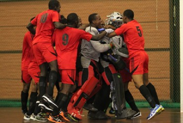 Team Guyana celebrating their bronze medal win over Argentina following the conclusion of the penalty shoot-out