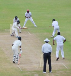 Man of the Match Davendra Bishoo plays a delivery during his unbeaten knock of 25 in the Guyana second innings  yesterday. (Clifton Ross photo)