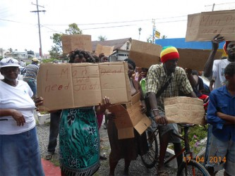 Residents outside the New Amsterdam Central Police Station yesterday protesting the shooting death of Errol Lindo.