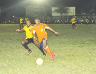 Fruta Conquerors winger Eon Alleyne (right) raced down the wing with Alpha United's Kelvin McKenzie in hot pursuit during their side's semi-final match-up.