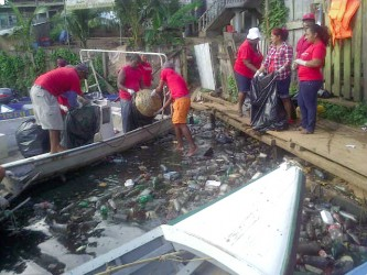 The clean-up of a section of the Port Kaituma River in full swing. A total of 730 bags of garbage were eventually collected.