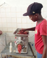 Dedeen Pluck, a worker at the Rising Sun beef farm, showing  how minced meat is made