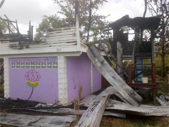 The top flat of the house in North Ruimveldt was ripped apart by the fire