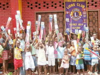 Children of Leopold Street rejoice as they hold their kites in the air