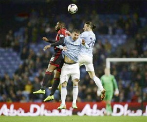 Manchester City's Martin Demichelis (R) and Aleksandar Kolarov (C) challenge West Bromwich Albion's Victor Anichebe during their English Premier League soccer match at the Etihad stadium in Manchester, northern England yesterday.