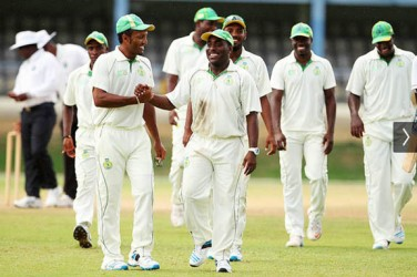 Liam Sebastien and the Windward Islands team celebrate their defeat of Trinidad yesterday. (Photo courtesy WICB media)