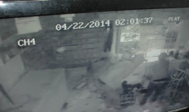 A still from the security footage of the burglary.