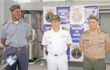 Left to right: GDF Coast Guard Commander Gary Beaton, Brazilian Navy Captain Jackson Sales and Brazilian Military Attaché Colonel Ronaldo Pacheco on deck of the Bocaina