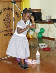 Little Magnolia Legall of the Tuschen Nursery in her element as she recites a poem in dramatic form at the opening ceremony of the Guyana Teachers' Union (GTU) 4th Biennial Conference last evening.