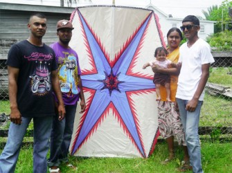 Shazaad Mohood, his wife Reshma and their five-month-old baby along with two friends, Ansar and Nicky pose with the kite before taking sending it up in the air.