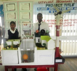 Uitvlugt Secondary School's project is a 'Flood Detector with Automatic Sluice'. Two students stand ready to explain it at the opening of the National Science Mathematics and Technology Fair at the Anna Regina Secondary School, Essequibo Coast.