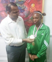 Cassey George during a courtesy call on the Minister of Sport, Dr. Frank Anthony yesterday.