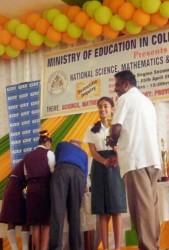 A student of the Abrams Zuil Secondary School receives the award for Best Oral Presentation for the upper secondary category at the National Science, Mathematics and Technology Fair 2014.