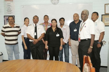 Egbert Fields (second from right) poses with members of the airline's operations team including Operations Manager Captain Learie Barclay (third from left). Giovani Charles (third from right) and Nirvana Mahase (centre) are also in the photo.