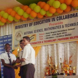 A President's College student receives the award for first place in the open category on behalf of her school at the National Science, Mathematics and Technology Fair 2014.