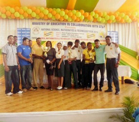 Organizers and students of Region Two pose with the trophy after the region was named Best Overall Region at the National Science, Mathematics and Technology Fair 2014