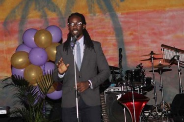 Yaphet Jackman performing a spoken word poem at the album launch. (Photo by James Gulliver)
