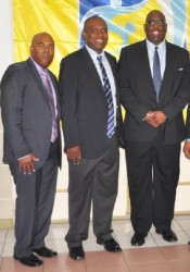GFF President Christopher Matthias (centre) posing with FIFA Developmental Officer Howard McIntosh (right) and CONCACAF Legal Advisor Bruce Blake following the conclusion of the congress (Orlando  Charles photo)