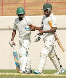 Jermaine Blackwood and Nkrumah Bonner yesterday shared a record second wicket partnership for Jamaica of 180 runs to put their team in a strong position on the opening day of the WICB regional final against the Windward Islands at the Beausejour Ground. Photo by WICB Media/Randy Brooks of Brooks Latouche Photography