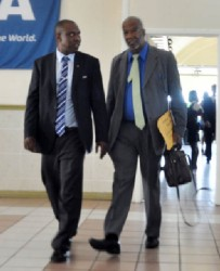 GFF President Christopher Matthias (left) sharing a word with GFA General Secretary Odinga Lumumba following the latter's returning to the congress after walking out (Orlando  Charles photo)