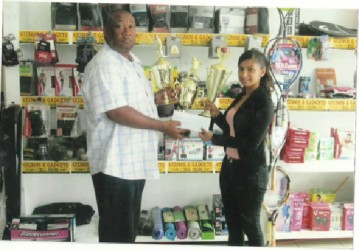 Gizmos and Gadgets Marketing Manager Divya Sieudarsan hands over sponsorship to RHTYSC Secretary/CEO Hilbert Foster.