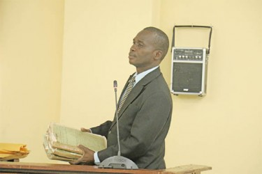 Crime Chief Senior Superintendent Leslie James with some of the file pertaining to the death of Dr. Walter Rodney which he brought before the commission yesterday. A total of six files, three each from the Special Branch and the Criminal Investigations Department (CID) were accepted as evidence.