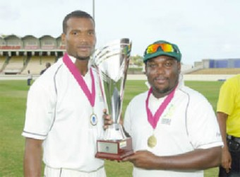 Jamaica skipper Tamar Lambert, right and David Bernard Jnr with the Weekes/Headley Trophy. (Photo courtesy WICB media)