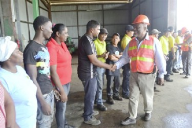 Meeting Barama workers: Prime Minister Samuel Hinds (right) greeting employees of Barama Company Limited when he visited over the weekend. (GINA photo)