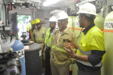Prime Minister Samuel Hinds (second from right) touring the operations plant at Aurora Gold Mines. (GINA photo)
