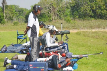 National captain Mahendra Persaud (standing) oversees team training at the Timehri ranges Sunday.