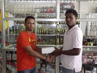 Ato Singh (left) of Tiger Sport presents the balls to Benedict Prince of Quest International.