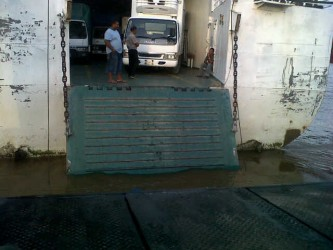 The ramp of the MV Kanawan in the water at Supenaam. In the foreground is the tarpaulin of the truck that plunged overboard.