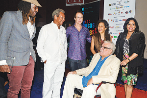 Finalist for the 2014 OCM Bocas Prize for Caribbean Literature Kei Miller, left, 2012 OCM Bocas Prize for Caribbean Literature winner Earl Lovelace, 2014 winner Robert Antoni; founder and director of the NGC Bocas Lit Fest Marina Salandy-Brown and OCM chief executive officer Dawn Thomas chat with 2011 winner, Nobel laureate Derek Walcott, at NAPA, Keate Street, Port of Spain, on Saturday.
