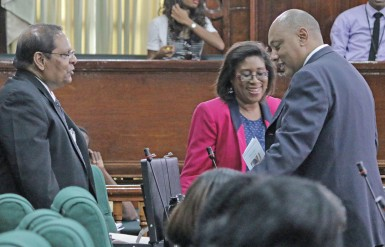Speaker of the National Assembly, Raphael Trotman (right) in conversation yesterday in Parliament with AFC MPs Cathy Hughes (centre) and Moses Nagamootoo.