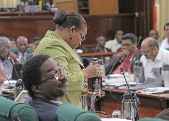 APNU MP Volda Lawrence holding up a bottle of rum as she argued that alcohol was a major scourge in the country that had to be addressed. She was contributing to the budget debate.