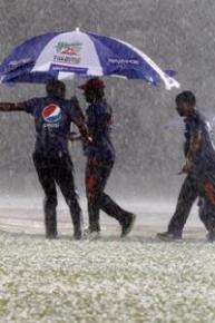 Ground-staff work work assiduously as rain and hail cover the ground at the Shere Bangla Stadium on Thurday. (Photo courtesy WICB Media)