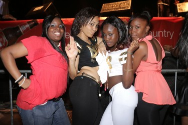 These girls posed for the camera at the Sean Paul and Jah Cure concert at the National Stadium on Monday.