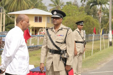 New Acting Police Commissioner Seelall Persaud (centre) having a chat yesterday with Minister of Home Affairs Clement Rohee before the start of the police officers conference.