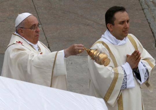 Pope Francis swings incense as he celebrates mass during the canonisation ceremony in St Peter's Square at the Vatican, April 27, 2014.  Credit: Reuters/Stefano Rellandini