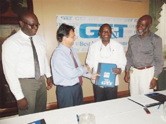 L-R – GT&T's Chief Financial Officer Justin Nedd, GT&T CEO Mr. R.K Sharma, UG's Vice Chancellor Prof. Jacob  Opadeyi and UG's Registrar Mr. Vincent Alexander at yesterday's signing.  (GT&T photo)