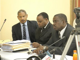 (from left) Andrew Pilgrim, who represents Walter Rodney's wife and children and Keith Scotland, who represents Donald Rodney sitting at the CoI.